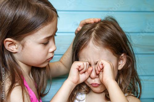 Fotografie, Obraz  The girl calms her crying friend. Children's friendship, support