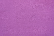 Background Of Painted Rough Stucco Purple Wall.