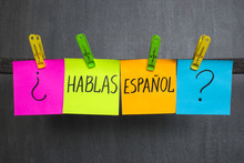 Colorful Notes With Question Do You Speak Spanish On The Dark Background.