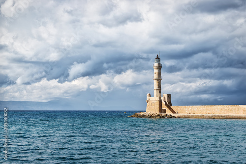 Papiers peints Europe Méditérranéenne Lighthouse in the Old Venetian Harbour in Chania . Crete. Greece.