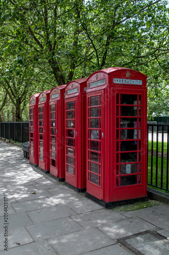 Typical red telephone booths in central London Poster