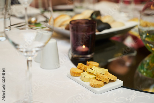 Poster  Assortment flavored aromatic butter on breakfast table, close-up