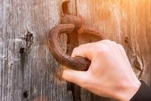 Old Bell At The Door, Hand Knocks On The Wooden Door