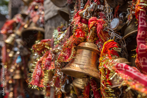 Bells in hindu Kamakhya Mandir temple in Guwahati, Assam state, North East India Wallpaper Mural