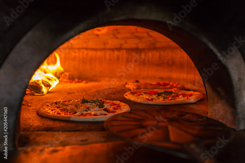 Keuken foto achterwand Pizzeria Original neapolitan pizza margherita in a traditional wood oven in Naples restaurant, Italy