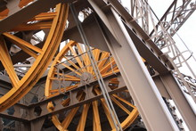 Yellow Wheels In Metal Architecture