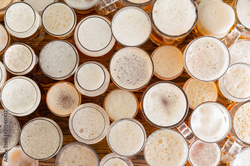 assortment-of-full-frothy-beer-glasses-and-sizes