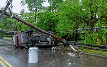 Electricity Poles Fall Because Of Storms. Damaged Car