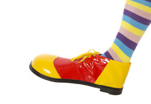 A Clown Foot Stepping Into Frame, Isolated On White.