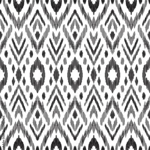 Foto auf AluDibond Boho-Stil Tribal pattern. Seamless background. Scribble texture. Black and white graphic design. Creative vector illustration. Ethnic boho ornament. Impressive fashion print.