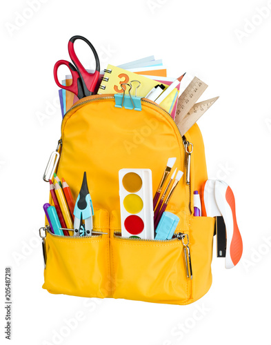 Yellow school backpack with school supplies isolated on white background Wall mural