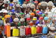 Leinwanddruck Bild - Traditional African wooden handmade dolls with seashells and colorful bead decoration at local craft market, Cape Town, South Africa. Souvenirs from Africa