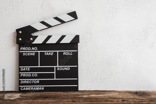 Photo Cinema clapperboard on wooden with white wall concrete background - Movie entert