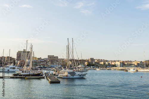 Foto op Canvas Poort Ships, yachts and sailboats docked in Siracusa, Sicily, Italy