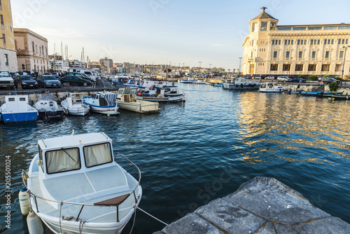 Staande foto Poort Fishing and recreational boats docked in Siracusa, Sicily, Italy