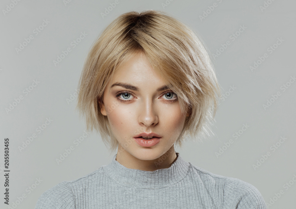 Fototapety, obrazy: Beauty portrait of female face with natural skin looking at camera isolated on grey