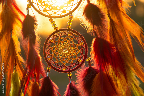 Fotografia  Handmade dream catcher with feathers threads and beads rope hanging