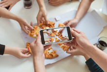 Photographing Food. Hands Taking Picture Of Delicious Pizza With Smartphone.