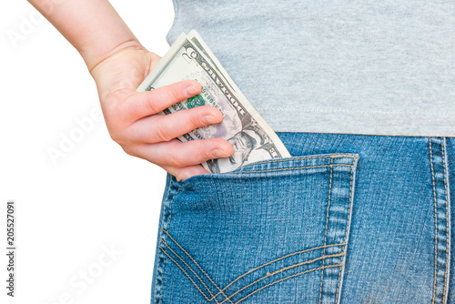 Woman's hand is putting dollar money in jeans pocket isolated on white backgroun Wallpaper Mural