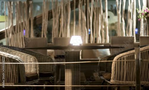 фотография  Evening tables of a street cafe
