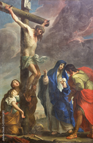 Vászonkép PARMA, ITALY - APRIL 16, 2018: The painting of Crucifixion in church Chiesa di San Antonio Abate by Giuseppe Peroni (1710 - 1776)
