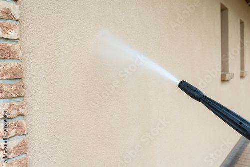 power washing the wall - cleaning the facade of the house