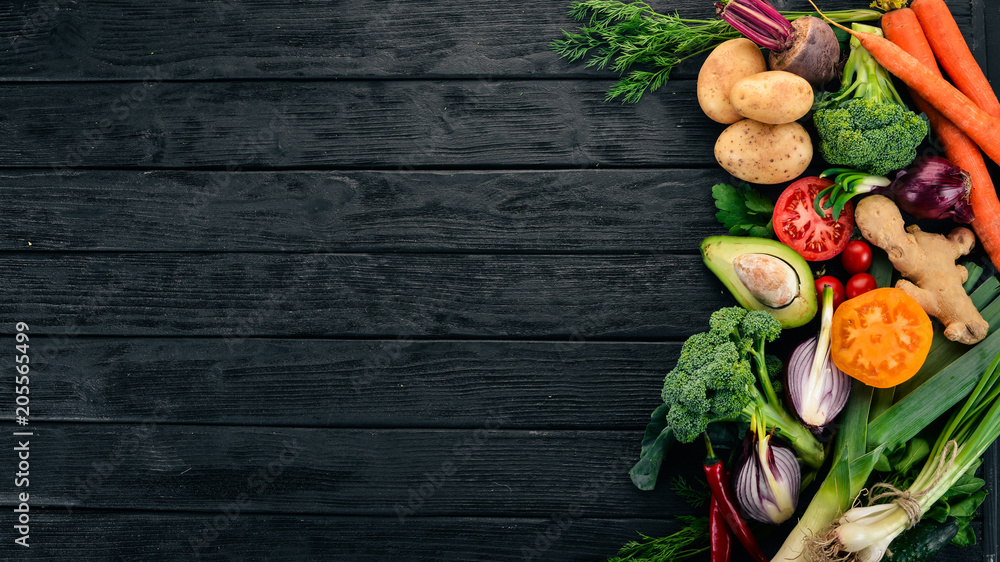 Fototapety, obrazy: Healthy food. Vegetables and fruits. On a black wooden background. Top view. Copy space.