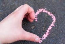 Child Hand Shows Heart Gesture