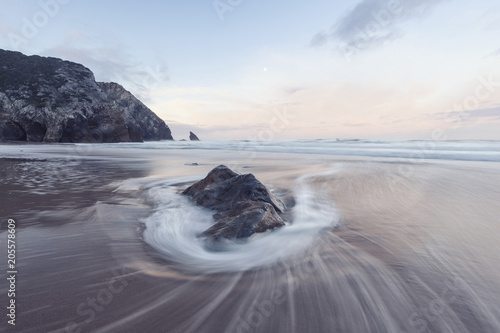 Keuken foto achterwand Water Scenic view of waves on shore at beach during sunset