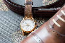 Men's Leather New Brown Shoes, Vintage Retro Luxury Gold Watch Closeup Still Life On Couch With Belt, Getting Ready Wedding Groom Or Interview Preparation Macro