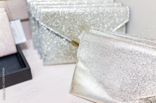 Obraz Closeup of wedding luxury expensive shiny white purses in boutique discount store, many selection on shelf display with glittering rhinestones - fototapety do salonu