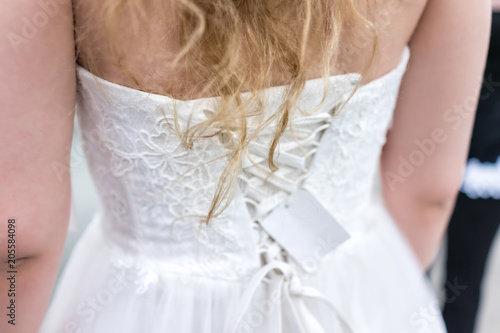 Closeup Back Of Young Woman Trying On Laced Corset Wedding Dress In Boutique Discount Store With Lacing Ribbon Blonde Hair Price Tag Buy This Stock Photo And Explore Similar Images At,Wedding Dress Shops Austin Tx
