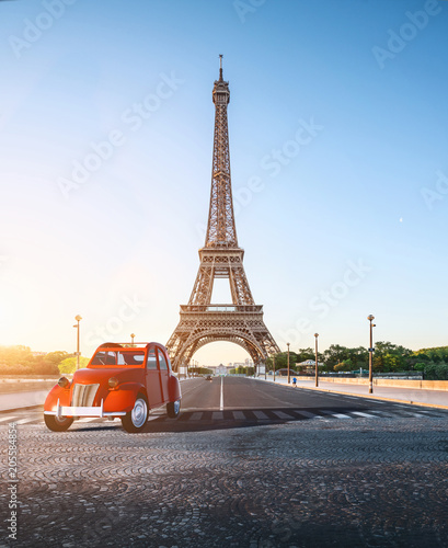 Fototapety, obrazy: Paris street with view on the famous paris eiffel tower on a sunny day with some sunshine
