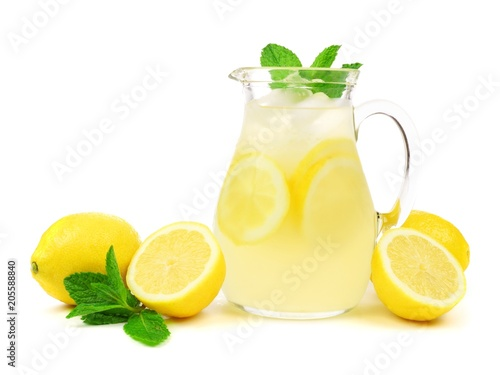 Fotografia Jug of summer lemonade with lemons and mint isolated on a white background