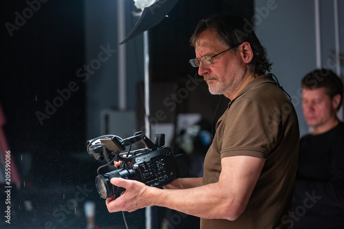 Photo  camera operator working with a cinema camera