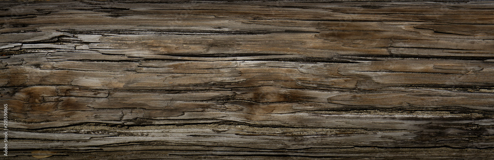 Fototapeta Old Dark rough wood floor or surface with splinters and knots. Square background with flooring or boards with wood grain. Old aged timber in a barn or old house.