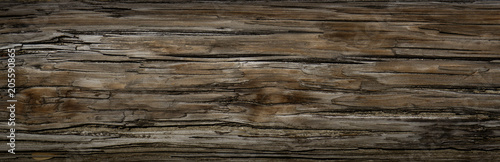 Old Dark rough wood floor or surface with splinters and knots. Square background with flooring or boards with wood grain. Old aged timber in a barn or old house. - 205590865