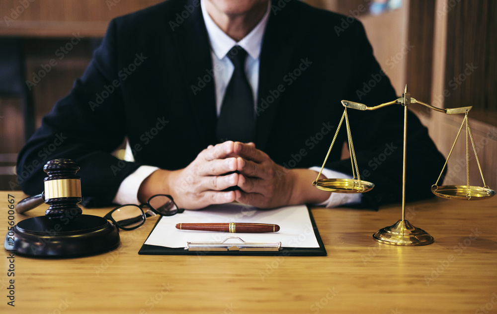 Fototapeta Judge gavel with Justice lawyers, Businessman in suit or lawyer working on a documents. Legal law, advice and justice concept