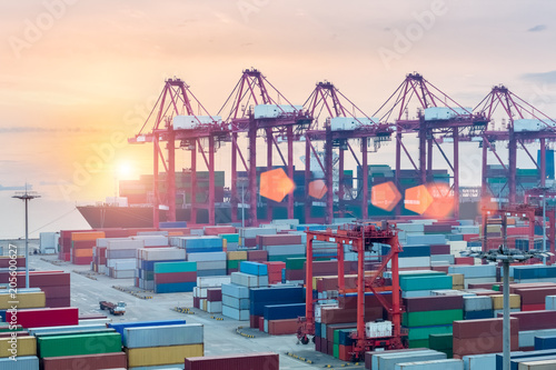 Staande foto Poort container terminal closeup in sunset