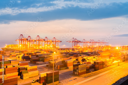 Foto op Canvas Poort modern container terminal in nightfall