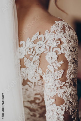 Vászonkép stylish bride detail, luxury lace gown on shoulder and red hair curl with veil, beautiful wedding dress