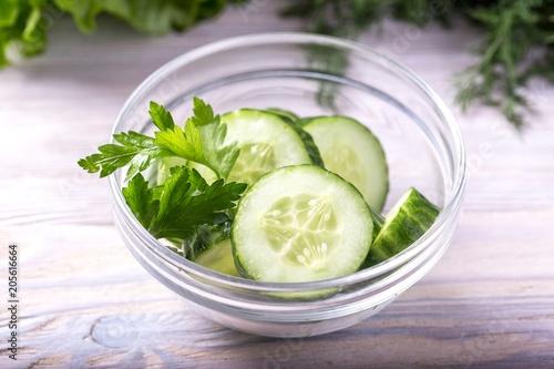 Fototapeta Sliced cucumbers. Fresh cucumber in a bowl obraz na płótnie