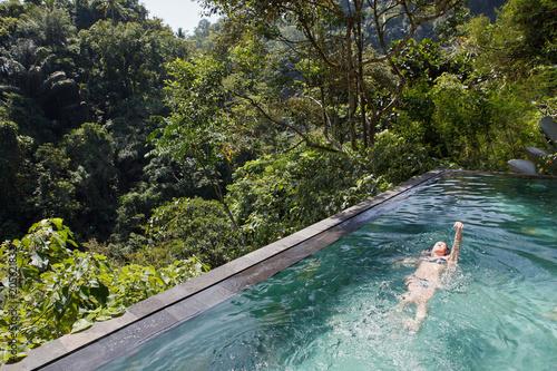 Aluminium Prints Bali girl in the tropic jungle pool swiming