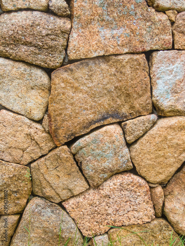 Foto op Plexiglas Stenen granite stone wall background rough texture concept