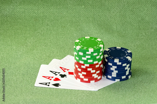 Cards for poker and colorful chips on a green cloth плакат
