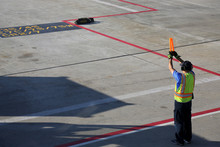 Ground Crew Signaling To Incom...