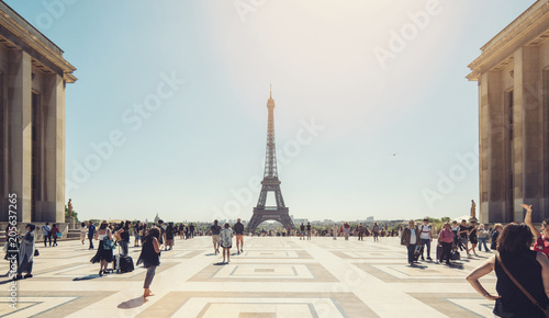 Eiffel tower seen from Trocadero square with crowd of people