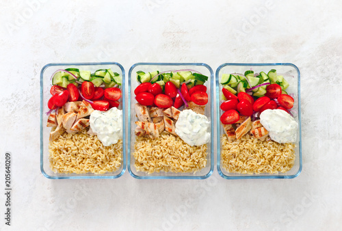 Foto op Canvas Kruidenierswinkel Greek chicken with tzatziki prepared and ready to eat in a take away lunch boxes