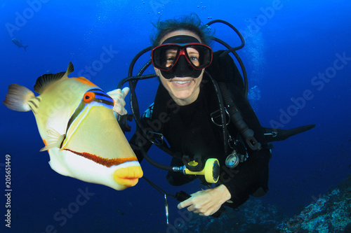 Scuba diving in ocean with fish