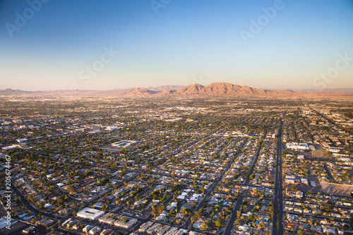 Fotobehang Las Vegas Aerial view across urban suburban communities seen from Las Vegas Nevada with streets, rooftops, and homes